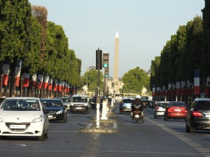 The Champs Elysees still decorated from Bastille Day and the upcoming finale of Le Tour de France.