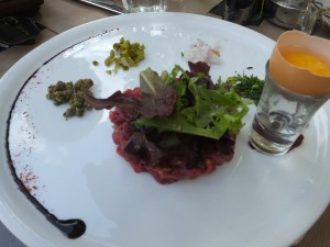 Bernie's steak tartar with all the fresh herbs and a raw egg ready to be mixed together.  It also had hazel nuts in it!  One of the best he's ever had.