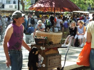 One of those unusual characters at the market.  Check out the doggie in the basket.