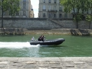 The police boat zipping down the water.