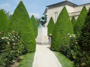 Another view of The Thinker and the beautiful garden atmosphere.