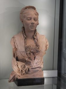 This bust was done in terra cotta. Notice the exquisitely crafted lace collar ruffle.