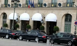 Main entrance to the Ritz characterized by rows of expensive cars