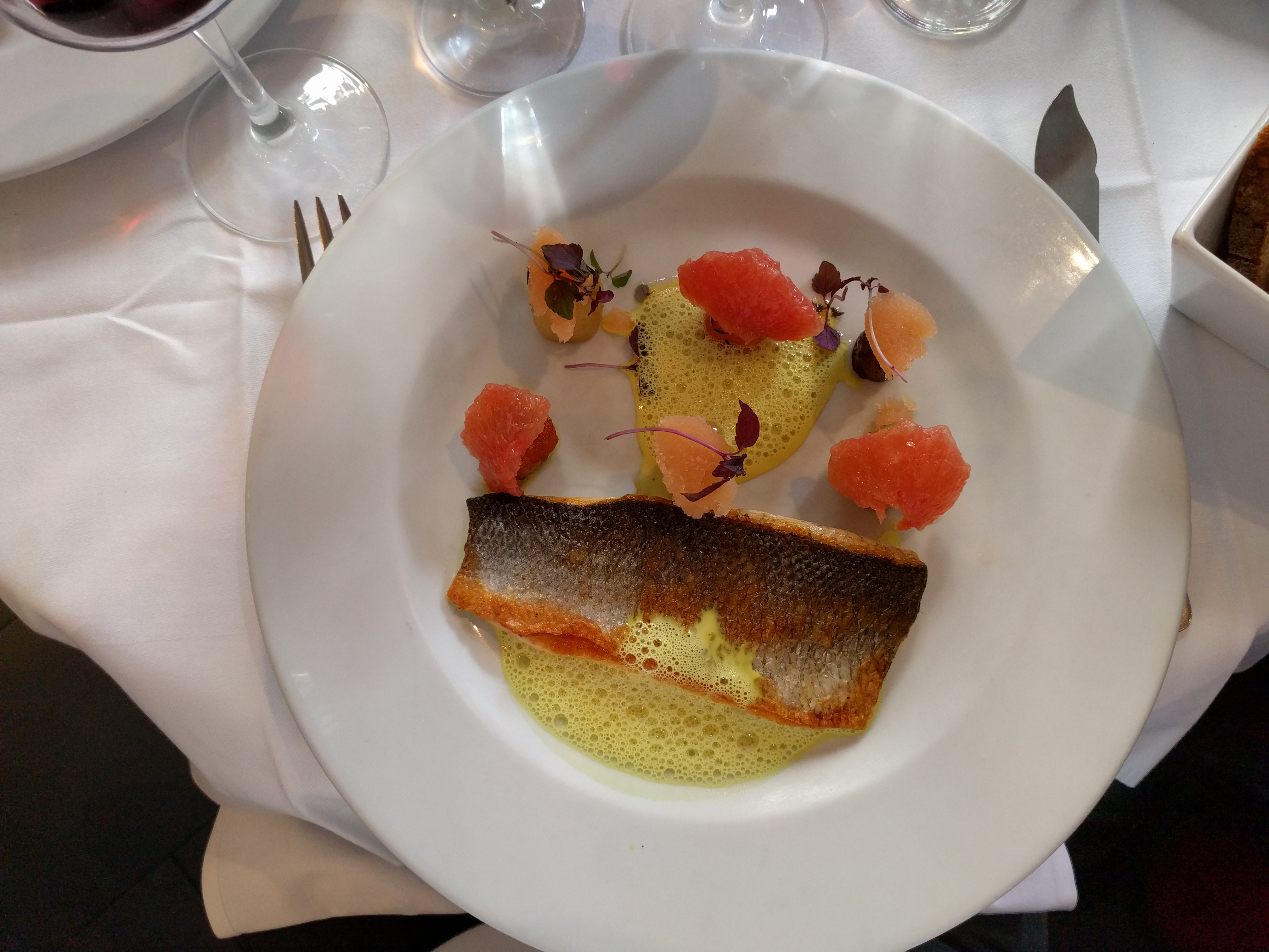 A main course of sea bass with carrots and grapefruit