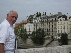 Bernie, pointing to our dream, pent-house apartment on Ile St. Louis