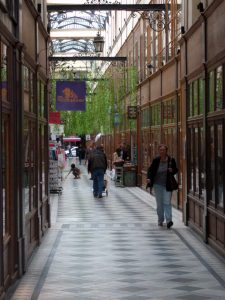 This is one of the ancient shopping arcades or passages in Paris called the Passage de Panoramic