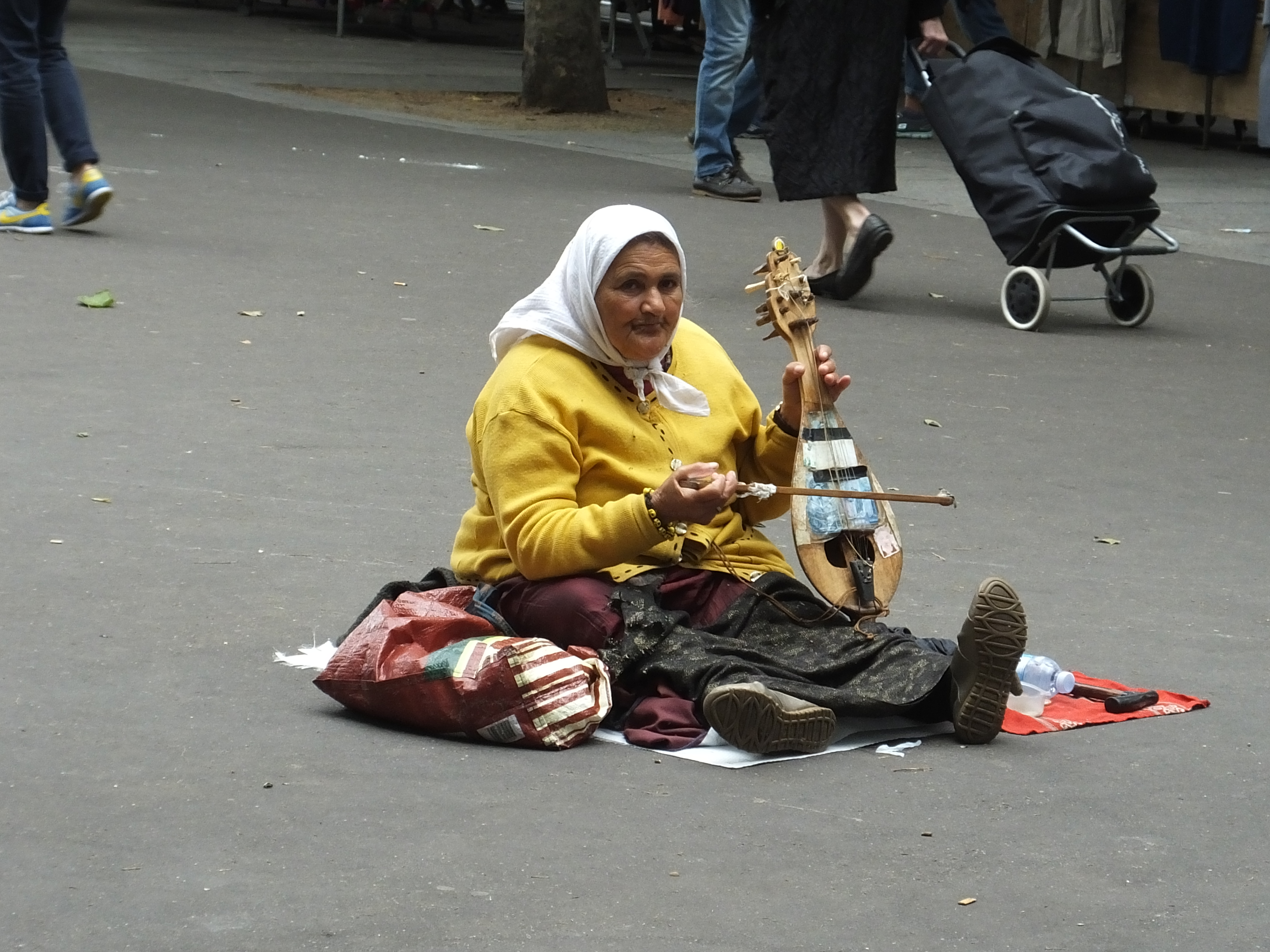 This lady plays the same note over and over and it will drive you crazy. People still give her money!