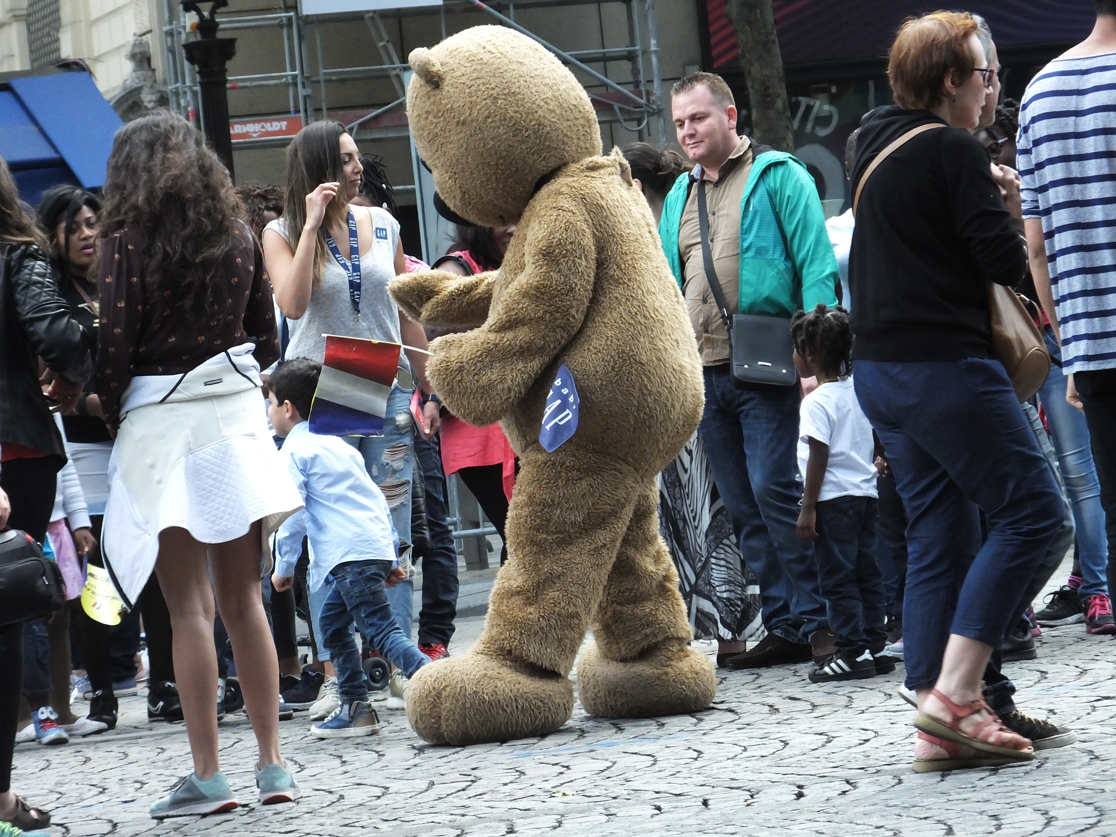 There was a big Teddy bear walking down the center of Les Champs